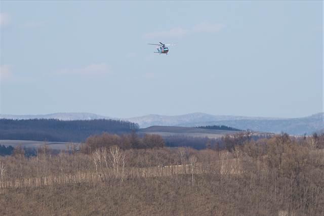 スピード違反取締りの警察ヘリコプター